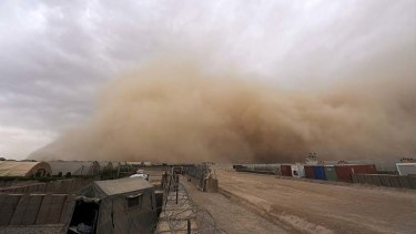 Blind spot: A sandstorm approaches the British forces' Camp Bastion in Helmand province.
