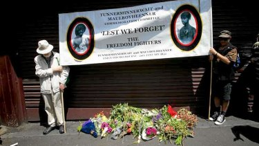 Not forgotten: Two men gather at the burial site at the Queen Victoria Market for two Aboriginal men.