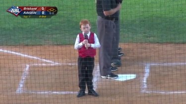 Ethan Hall takes a deep breath before starting the national anthem with a case of the hiccups.