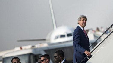 US Secretary of State John Kerry boards his plane at Cairo International Airport after talks with Egyptian President Abdel Fattah al-Sisi.
