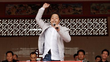 Zhuang Liehong makes his point forcefully at this week's rally in Wukan to introduce candidates to voters.