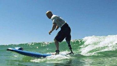 Swell time... shark attack victim Paul de Gelder hits the waves.