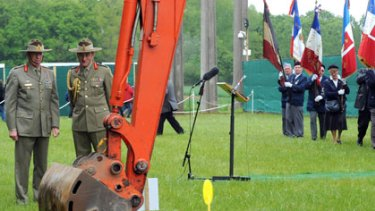 Sacred site ... Australian soldiers look at crane digging up a field in Fromelles, northern France, as forensic experts began to excavate a World War I mass grave were up to 400 Australians and Briton are thought to have been buried by German forces,
