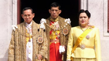 King Bhumibol Adulyadej, Crown Prince Maha Vajiralongkorn and Queen Sirikit in 1999.