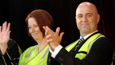 Prime Minister Julia Gillard and Mike Devereux at the launch of the new Holden Cruze at the Elizabeth car plant in Adelaide in February 2011.