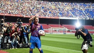 The homecoming: Cesc Fabregas is welcomed back to the Nou Camp on Tuesday.