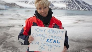 Emma Thompson calls out to Tony Abbott from the top of the Arctic glacier Smeerenburg.