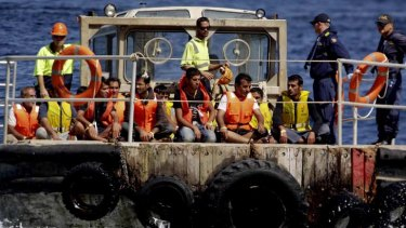 Asylum seekers being transferred to Christmas Island.