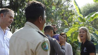 Heated stand-off... Sydney vet and the Wildlife Friends Foundation Thailand manager, Lucy Clark, confronts Thai park officials during the raid.