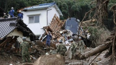 Japanese soldiers search for survivors after the landslide.
