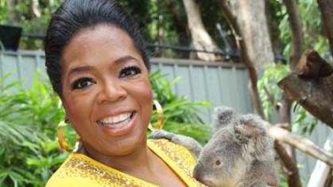 Oprah Winfrey meets a koala at Hamilton Island Wildlife Park.