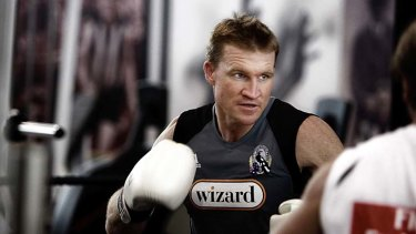 Tonight's coaches: Nathan Buckley and (below) Chris Scott.