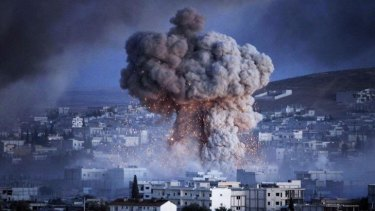 An explosion rocks the Syrian city of Kobane during a reported suicide car bomb attack by the militants of Islamic State.