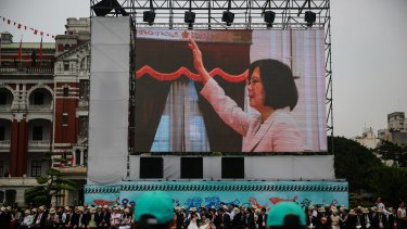 Taiwan's incoming president Tsai Ing-wen is seen on a screen as she is sworn in on Friday.
