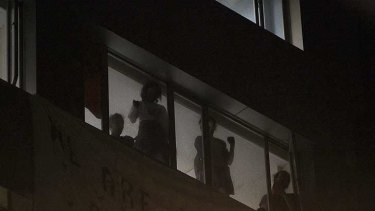 Occupying ...  protesters wait for police to evict them from an empty Clarence Street office building last night.