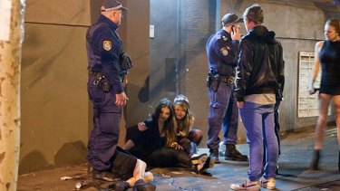 ''Just another Friday night'' … police attend to an intoxicated teen in Kings Cross.