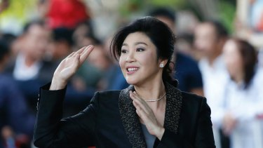 Former Thai prime minister Yingluck Shinawatra waves to supporters as she arrives at the Supreme Court for her final statements on August 1.