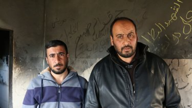 Hassan Dawabshe, left, the brother of Riham Dawabshe, and Nasser Dawabshe, the brother of her husband Saad, in the house where the couple and their son were fatally wounded in an arson attack.