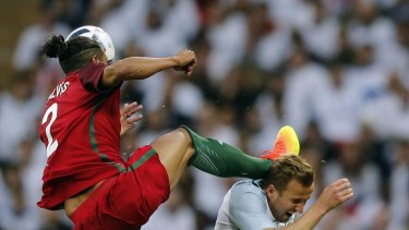Red mist: Bruno Alves challenges Harry Kane at head height.