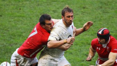 Captains collide ... Chris Robshaw of England is tackled by Sam Warburton.