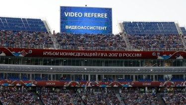 Break in play: A giant screen reports an incident is being investigated by VAR during the 2017 Confederations Cup.