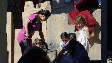 Displaced Iraqi women and children in the St Joseph church in the village of Ankawa, north of the Iraqi city of Erbil.