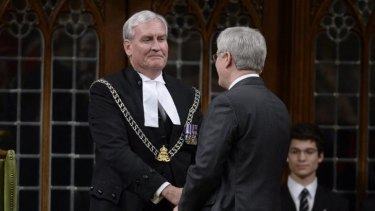 Prime Minister Harper shakes hands with  Sergeant-at-Arms Kevin Vickers in the House of Commons.