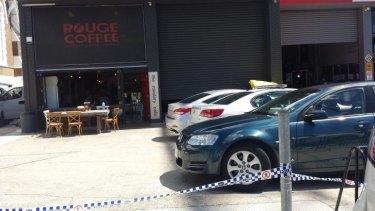 Police conduct raids in South Brisbane.