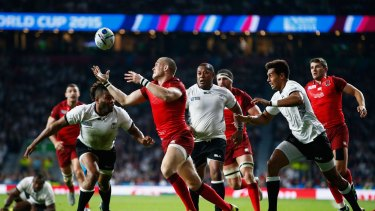 Good start: Mike Brown  breaks through to score the third try for England.