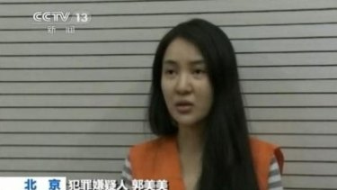 Guo Meimei making her 'confession' on CCTV.