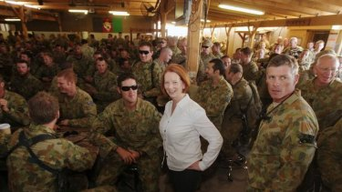 Prime Minister Julia Gillard meets with Australian Defence Force personnel for a BBQ lunch during her visit to the Multi-National Base in Tarin Kowt.