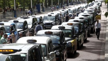 London taxi cabs parked in protest against Uber in 2014.