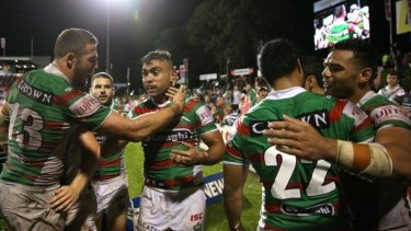 Merritt reward: South Sydney players congratulate Nathan Merritt after the winger scored his 145th try for the club, taking him past Benny Wearing's previous record.