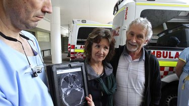 Making progress: Angela and Phillip Cramp, the parents of bashing victim Simon, with Dr Anthony Grabs, the head of trauma at St Vincent's Hospital.