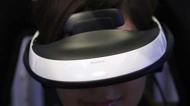 "A model demonstrates using Sony's head mounted display ""Personal 3D Viewer HMZ-T1"" at its product launch in Tokyo."