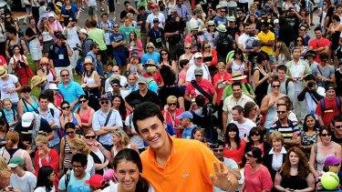 Bernard Tomic and sister Sara pose for crowds at Garden Square.