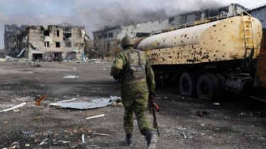 Division: A Pro-Russian separatist at the Donetsk's international airport.