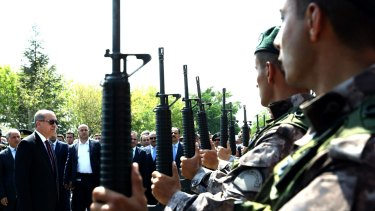 Turkish President Recep Tayyip Erdogan, in sunglasses, reviews police special forces at their headquarters in Ankara on Friday.