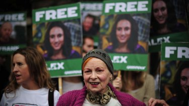 Vivienne Westwood stands in front of an Alex Harris poster as she takes part in a protest against the detainment of Greenpeace activists.