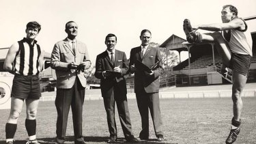 Helping Jim Cleary and Bruce Andrew judge Bob Skilton for the World of Sport Longest Kick Competition at the Junction Oval in St Kilda 1962.