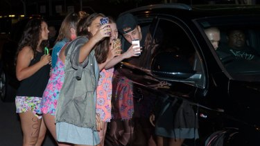 Justin Bieber has his photo taken with fans in Brisbane on November 24, 2013.
