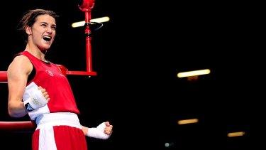 Irish hope ... Taylor celebrates after beating Jonas.