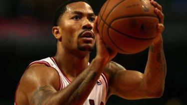 17da02275a8 Chicago Bulls guard Derrick Rose shoots a free throw against the Detroit  Pistons during a preseason