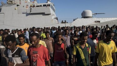 Steady stream: An estimated 400 people in up to 20 boats make the crossing each day.