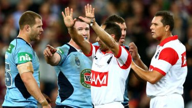 The fallout: Trent Merrin feels the referee's wrath.