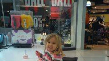 Questioned by police... Chris White found himself in trouble for taking this picture of his daughter Hazel in a Scottish shopping centre.