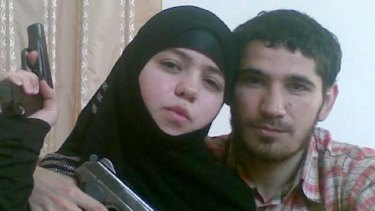 Pistol pose … the 17-year-old widow with her husband.