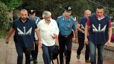 Arrested ... mozzarella king Giuseppe Mandara, centre.