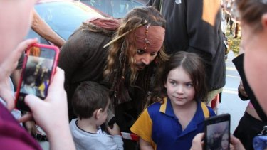 Johnny Depp meets the crowds while filming at Raby Bay east of Brisbane.