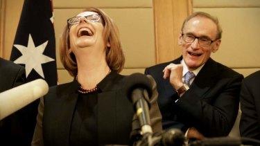 Julia Gillard and Bob Carr at a press conference in Beijing.